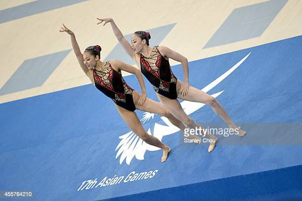 Hikaru Kazumori and Risako Mitsui of Japan prepares to compete during the Synchronised Swimming Duet Free Routine Final during day one of the 2014...