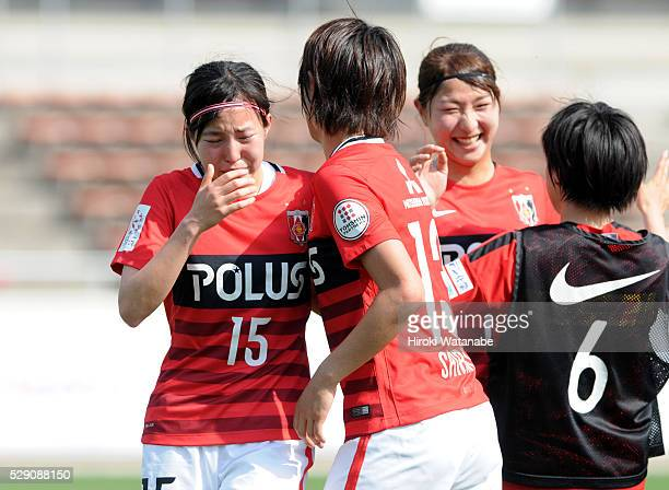Hikaru Kitagawa and Akari Shiraki of Urawa Red Diamonds Ladies celebrate their team's 10 win in the Nadeshiko League match between the Urawa Red...