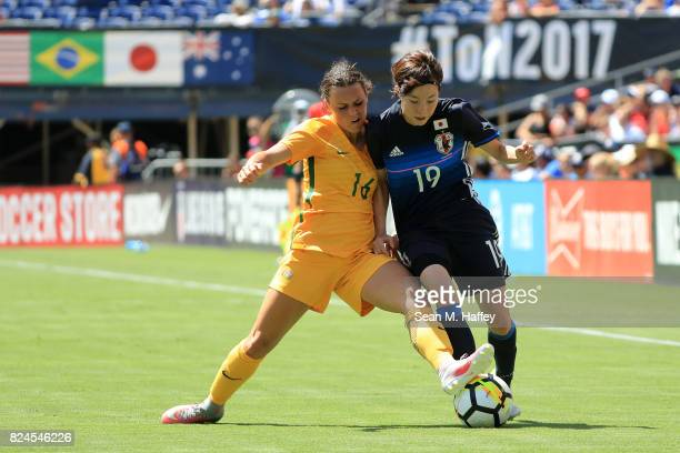 Hikaru Kitagawa of Japan battles Hayley Raso of Australia for a loose ball during the first half of a match in the 2017 Tournament of Nations at...