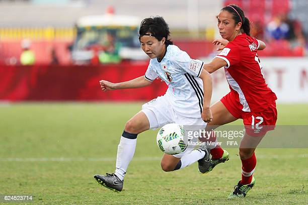 Hikaru Kitagawa of Japan gains control of the ball with pressure from Victoria Pickett of Canada during their Group B match in the FIFA U20 Women's...