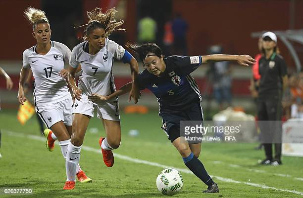 Hikaru Kitagawa of Japan holds off Delphine Cascarino of France during the FIFA U20 Women's World Cup Papua New Guinea 2016 Semi Final match between...