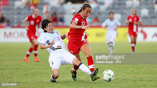 Hikaru Kitagawa of Japan tackles Victoria Pickett of Canada during their Group B match in the FIFA U20 Women's World Cup Papua New Guinea on November...