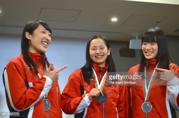 Hikaru Mori Ayano Kishi and Yumi Takagi smile during a press conference on arrival at Haneda Airport on November 14 2017 in Tokyo Japan