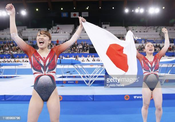 Hikaru Mori of Japan celebrates after winning the women's individual event at the trampoline gymnastics world championships in Tokyo on Dec 1...