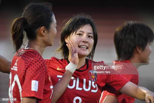 Hikaru Naomoto and Kozue Ando of Urawa Red Diamonds celebrate the win after the Nadeshiko League Cup Group A match between Urawa Red Diamonds and NTV...