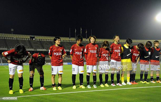 Hikaru Naomoto and players of Uwara Reds Ladies react after the 01 defeat in the Nadeshiko League match between Urawa Red Diamonds Ladies and INAC...