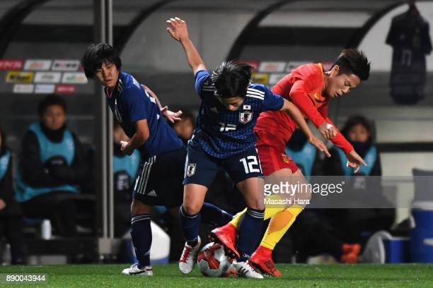 Hikaru Naomoto of Japan and Li Ying of China compete for the ball during the EAFF E1 Women's Football Championship between Japan and China at Fukuda...