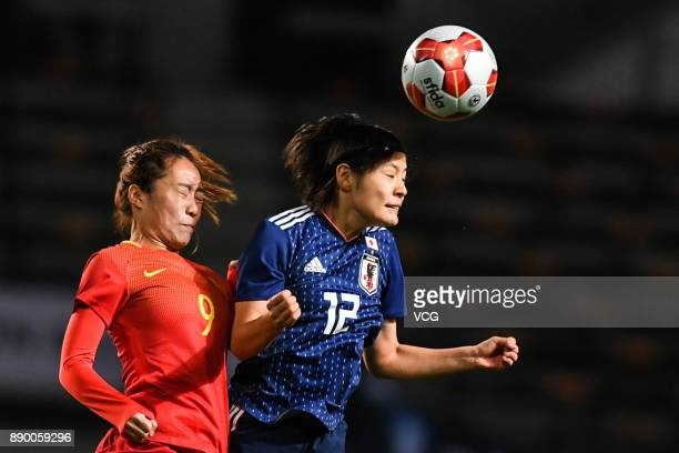 Hikaru Naomoto of Japan and Tang Jiali of China compete for the ball during the EAFF E1 Women's Football Championship between Japan and China at...