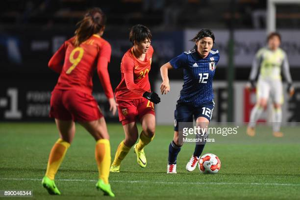 Hikaru Naomoto of Japan and Zhang Rui of China compete for the ball during the EAFF E-1 Women's Football Championship between Japan and China at...