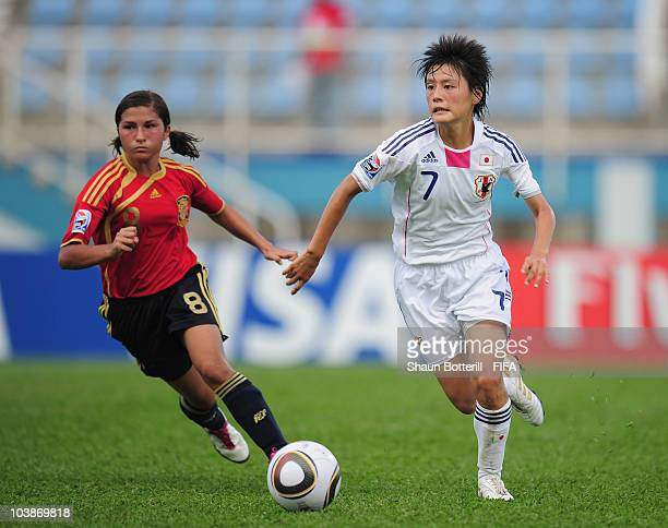 Hikaru Naomoto of Japan breaks away from Marina Garcia of Spain during the FIFA U17 Women's World Cup Group C match between Spain and Japan at the...
