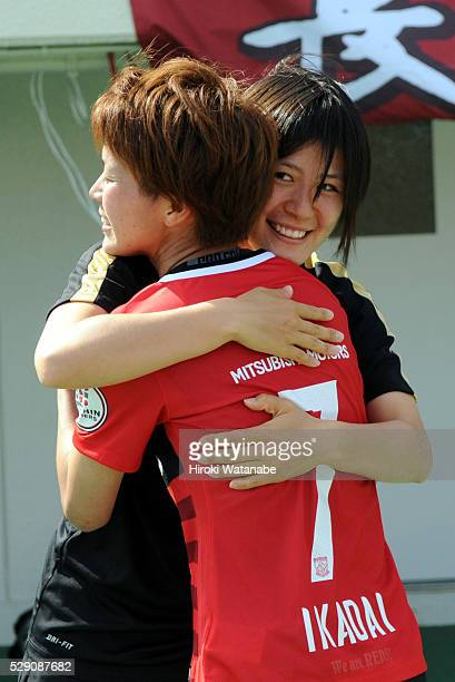 Hikaru Naomoto of Urawa Red Diamonds Ladies congratulates her team mate Risa Ikadai after the Nadeshiko League match between Urawa Red Diamonds...