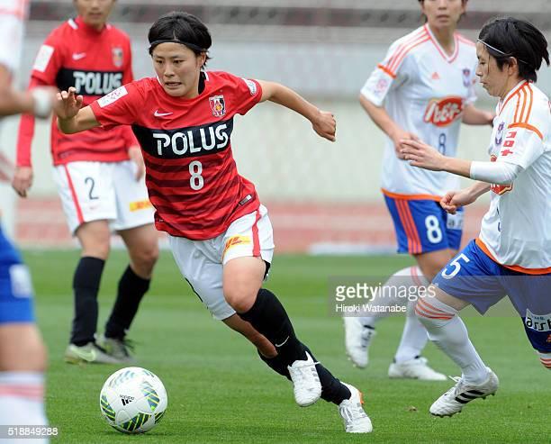 Hikaru Naomoto of Urawa Reds and Haruka Takahashi of Albirex Niigata compete for the ball during the Nadeshiko League match between Urawa Red...