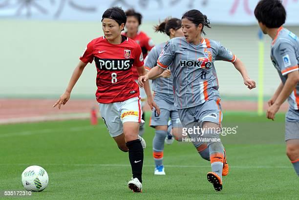 Hikaru Naomoto of Urawa Reds Ladies and Shiho Kunisawa of AC Nagano Parceiro compete for the ball during the Nadeshiko League match between Urawa Red...