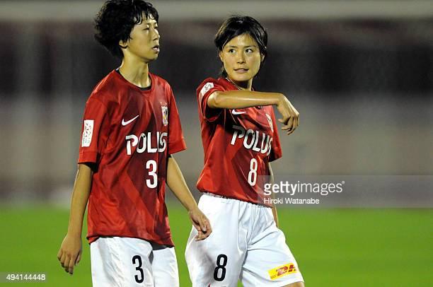 Hikaru Naomoto talks to Shiho Takahata of Urawa Red Ladies during the Nadeshiko League match between Urawa Red Diamonds Ladies and JEF United Chiba...