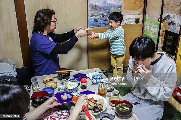 Hikaru Togawa 3 years old receives the New Year lottery from his father on January 1 2016in Tokyo Japan In Japan the New Year is celebrated with a...