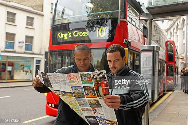 Hikawera Elliot and Alby Mathewson of the New Zealand All Blacks study a London street map outside their hotel in Kensington on November 1, 2010 in...