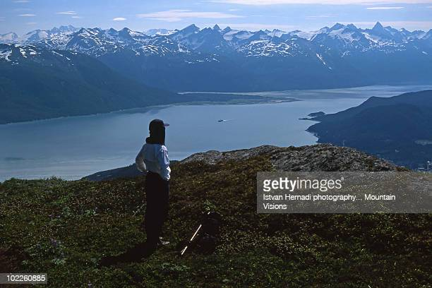 hiker above the lynn canal at haines - lynn pleasant stock pictures, royalty-free photos & images