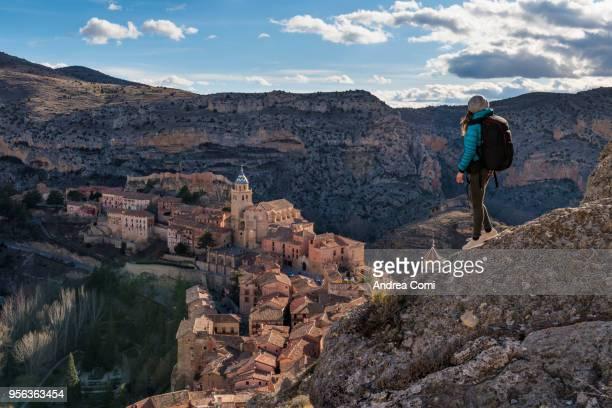 a hiker admires the view of albarracin. albarracin, teruel, aragon, spain - アラゴン ストックフォトと画像