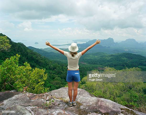 hiker admiring mountain landscape, thailand - hugh sitton stock pictures, royalty-free photos & images