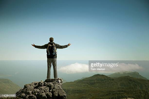 Hiker admiring rural landscape from mountaintop