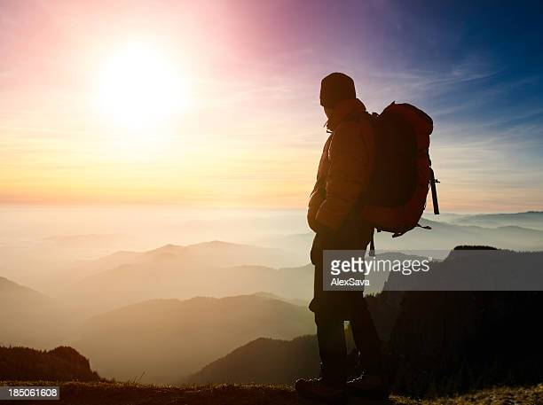 hiker admiring the sunset