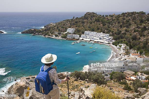 Hiker admiring view over the bay, Loutro, Crete