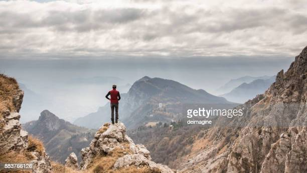 hiker alone admire mountain range - (position) stock pictures, royalty-free photos & images