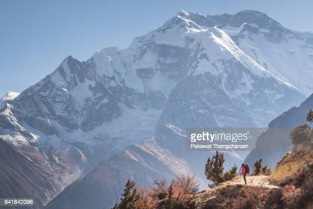 A Hiker and Annapurna II, Annapurna Conservation Area, Nepal