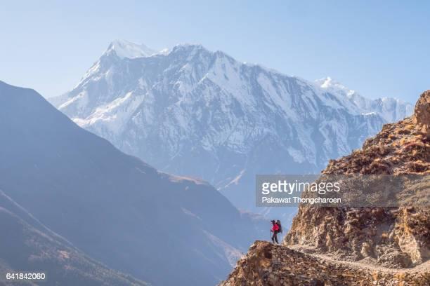 A Hiker and Annapurna III, Annapurna Conservation Area, Nepal
