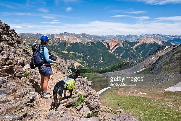 Hiker and Dog Looking at the View