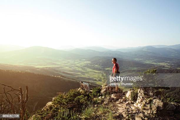 hiker and his dog reach summit with majestic views - americas next top dog stock pictures, royalty-free photos & images