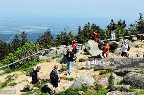 Hiker arriving the peak of Brocken Mountain