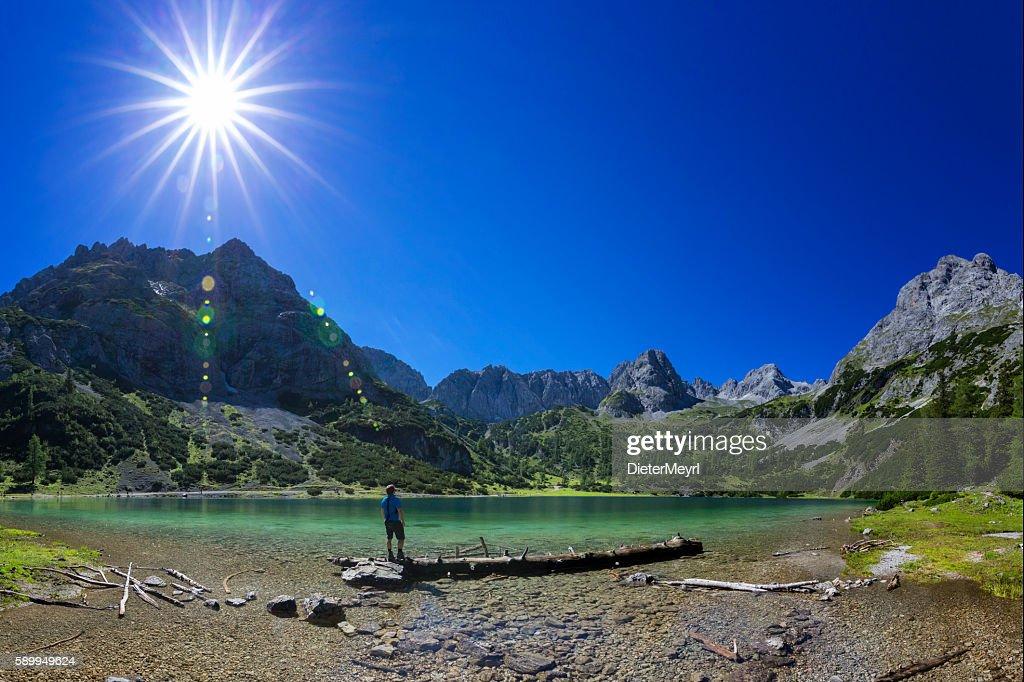 Hiker at alpin Lake at sunny day - Seebensee Tirol : ストックフォト