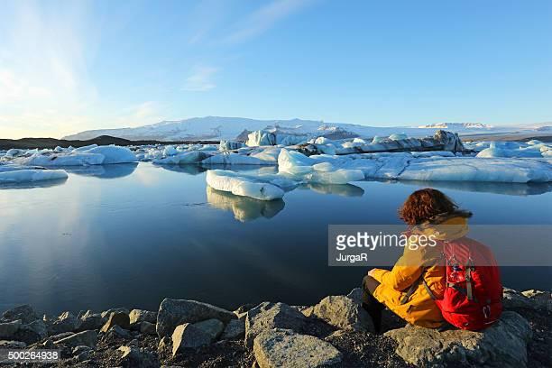 Hiker at Jokulsarlon Glacier Lagoon Iceland