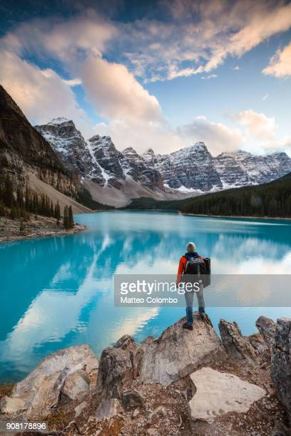 hiker at moraine lake at sunset, banff, canada - snowcapped mountain stock pictures, royalty-free photos & images