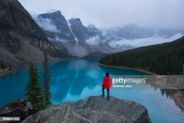 hiker at moraine lake, banff national park - lake louise stock photos and pictures