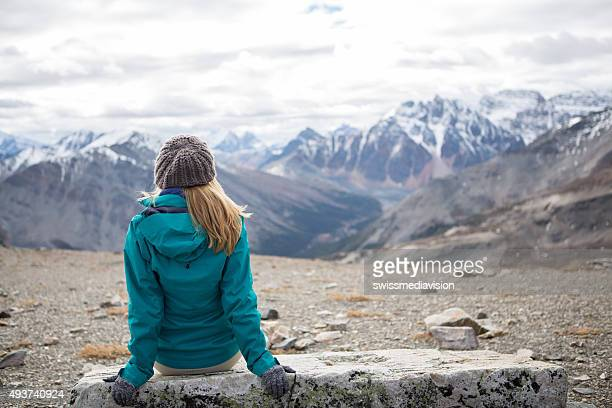 Hiker at mountain top enjoying landscape