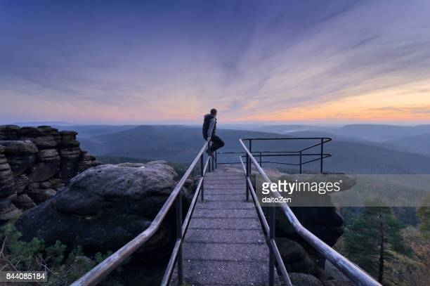 Hiker at observation point in Papststein hiking area, Saxon Switzerland National Park, Saxony, Germany