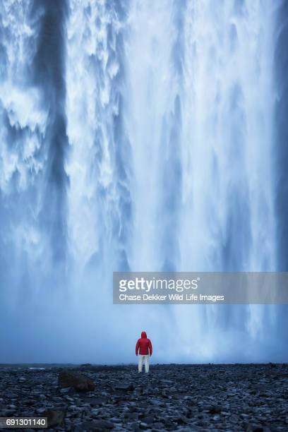hiker at skogafoss - waterfall stock pictures, royalty-free photos & images