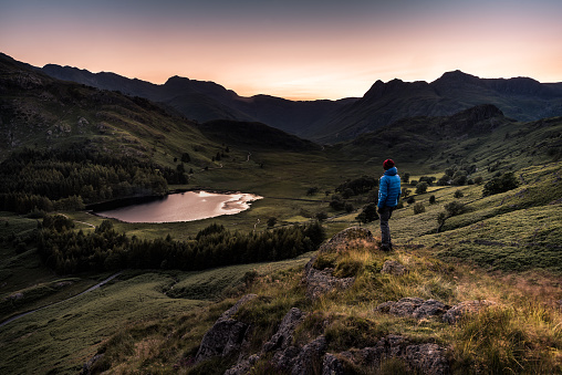 Hiker at sunset in the English Lake District - gettyimageskorea