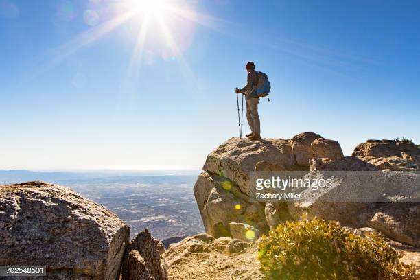 hiker at viewing point, cucamonga peak, mount baldy, california, usa - mount baldy stock photos and pictures
