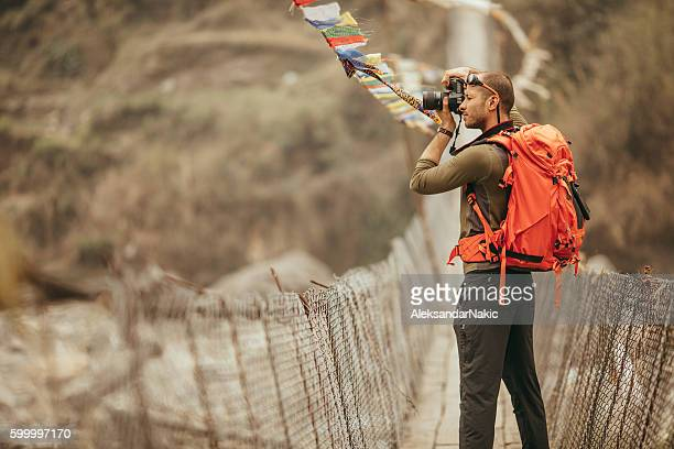 hiker capturing the view - nepal stock pictures, royalty-free photos & images