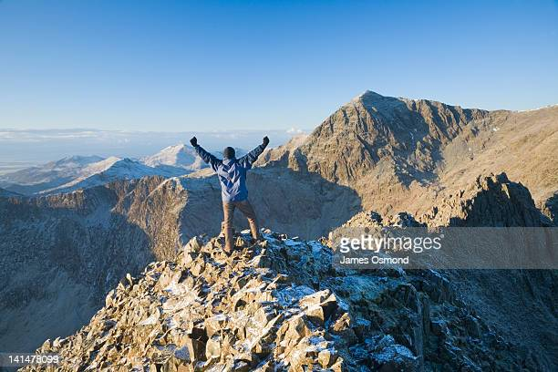 hiker celebrating on crib goch - mount snowdon stock photos and pictures