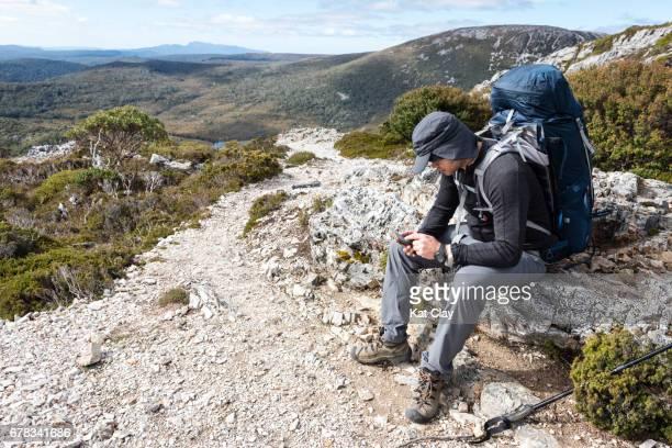Hiker checking smart phone