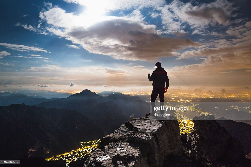 Hiker checks your device on top on the mount : Stock-Foto