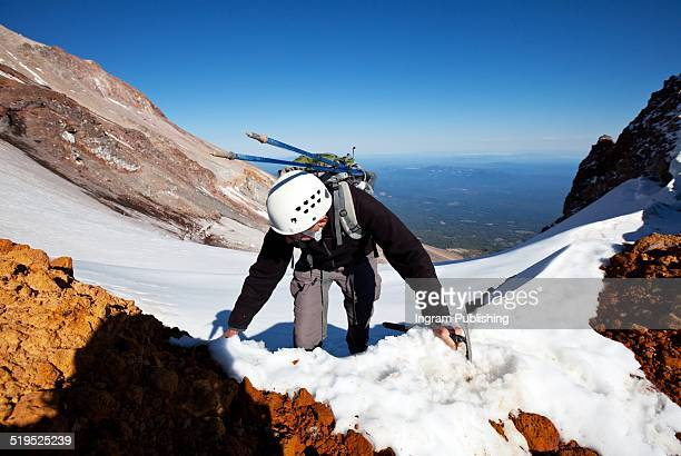 hiker climbing on mount shasta - mt shasta stock pictures, royalty-free photos & images