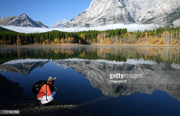 hiker contemplating the serenity of a mountain lake - kananaskis country stock pictures, royalty-free photos & images