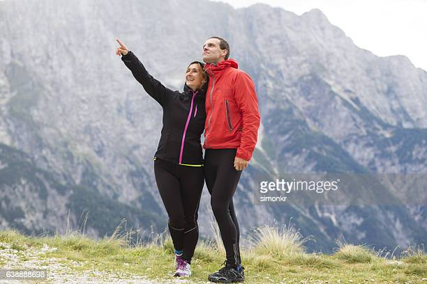 Hiker couple standing on mountain