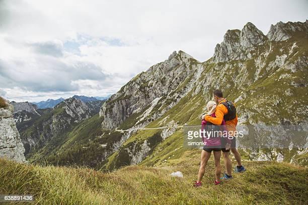hiker couple standing on mountain - korte broek stockfoto's en -beelden