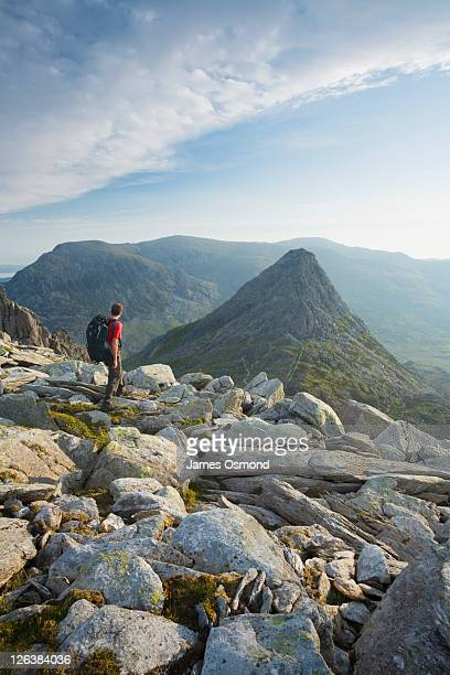 Hiker descending Glyder Fach towards Tryfan. Snowdonia National Park. Conwy. Wales.
